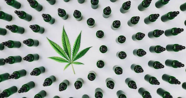 CBD Oil bottles and marijuana leaf